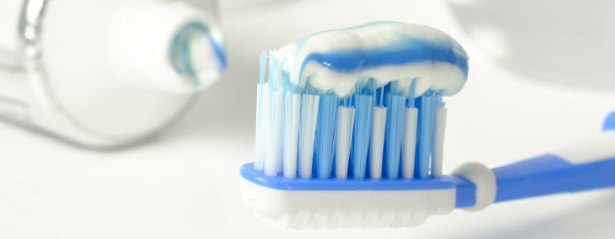 Blue And White Toothpaste On Toothbrush For Fresh Breath