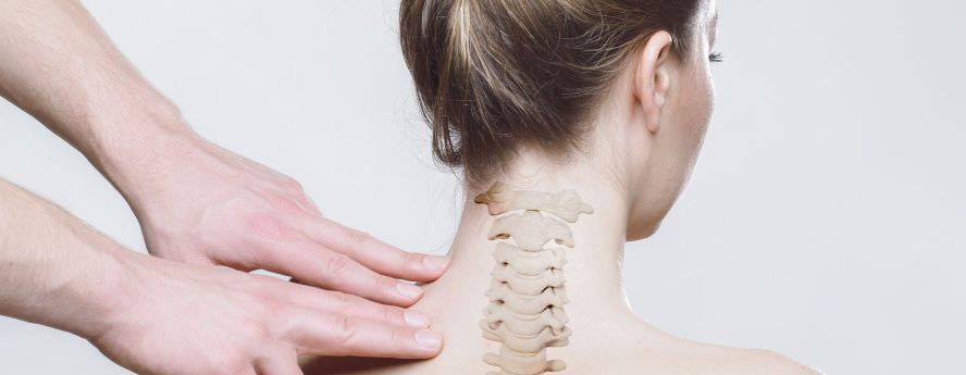 Person Massaging Women's Back Spine Problems And Pain