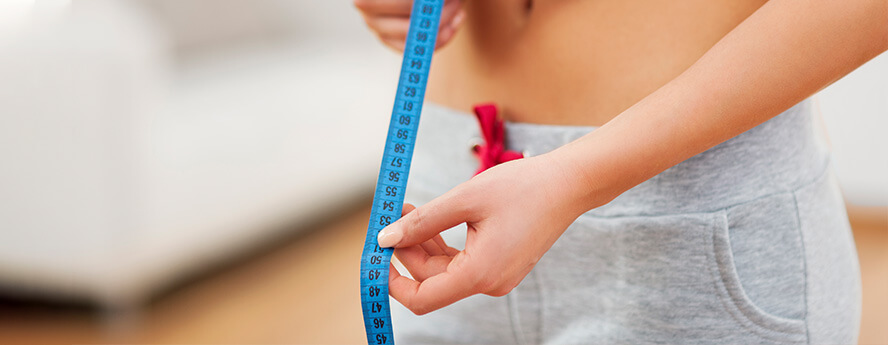 Healthy Women Measuring Waist With Tape